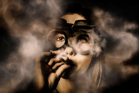 steampunk goggles: Creative art portrait on the face of a beautiful female mechanic smoking with industrial welding goggles in plumes of hot fumes. Steampunk welder