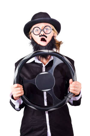 disguised: Woman disguised as man with beard holding steering wheel, defensive driver concept on white background.