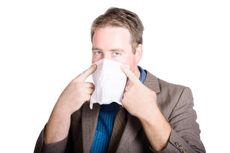 conscious: Health conscious business man covering face with tissue to prevent the spread of airborne bacteria. contagious diseases.