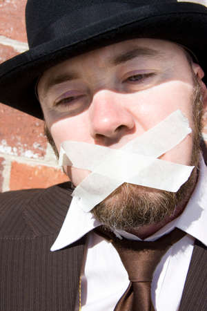 taped: Man With Taped Up Mouth Stares Unheard In A Sorrowful Expression As He Is A Victim Of The Voiceless Stock Photo