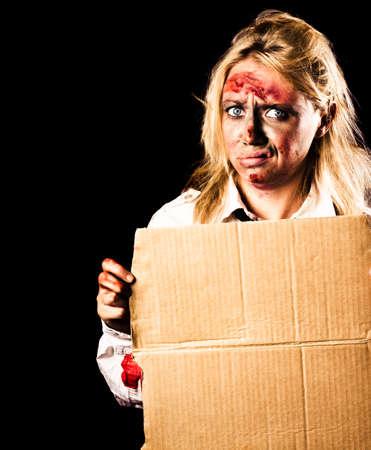 creepy hand: Creepy halloween monster holding blank cardboard sign in hand on black copyspace background