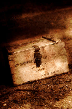 allied: Textured Grunge Photograph On An Allied Wooden Small Arms Cartridge Box Sitting On The Dirt In A Battle Field Trench During The Vietnam War