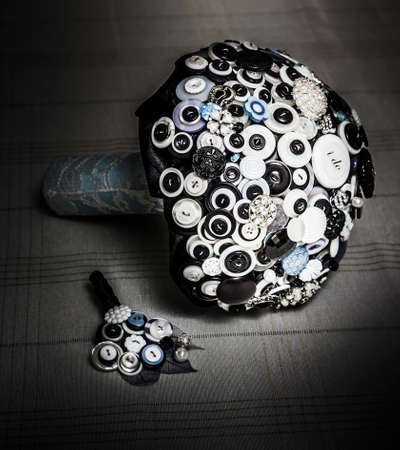 bouquets: Modern button design wedding bouquet with matching boutonniere