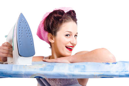 exalted: Isolated retro portrait of a smiling housewife wearing head scarf doing housework laundry duties with iron and board Stock Photo