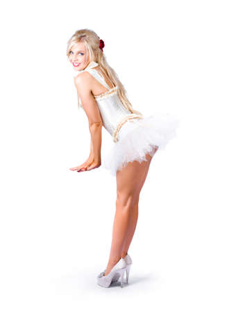 high heeled shoes: Glamorous pin-up girl in short white dress and high heeled shoes Stock Photo