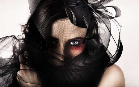 depiction: Creative Dark Portrait Of A Female Vouge Fashion Model Wearing Vintage Style Headwear In A Depiction Of Elegant Luxury