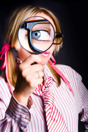 dweeb: Blue Eyed Nerd With Enlarged Pupil Looking Through Magnifying Glass When Spying for Unsolved Business Clues