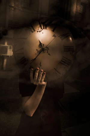 old fashioned sepia: Mystery Woman Holding The Concept Of Time In Her Hands And Hiding Behind A Clock Face As Time Passes In A Mysteries Of Time Concept