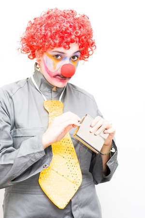 sneaks: A Clown Is Caught With A Guiltily Expression While Sneaking Out A Hipflask To Have A Quick Alcoholic Drink In A Work Blues Concept