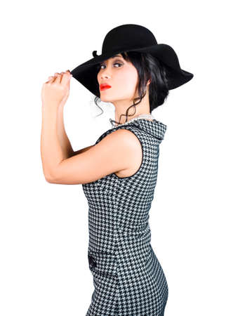 jaunty: Young beautiful asian brunette in gorgeous retro dress paired with matching headwear Stock Photo