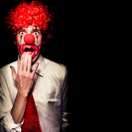 scary clown: Scary Clown With Shocked Expression Isolated On Black Background.