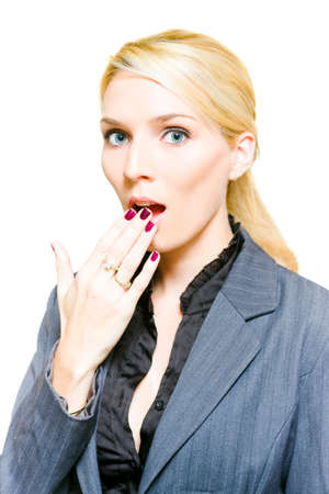 dismay: Surprised Started And Shocked Business Woman Holds Hand Up To Her Mouth In A Gesture Of Dismay Dread And Shock Horror, Image Isolated On White Background Stock Photo