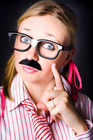 imperious: Odd female business scientist wearing moustache gesturing knowledge to the solution when answering a complex business equation