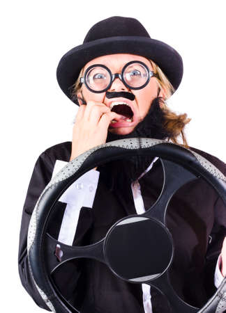 woman clothes: A woman in drag, wearing mens clothes and a fake beard, with a steering wheel with scared expression Stock Photo
