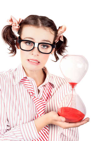 running out of time: Isolated Late Business Woman Under Stress Holding Hourglass Time Clock Running Out Of Sand Stock Photo
