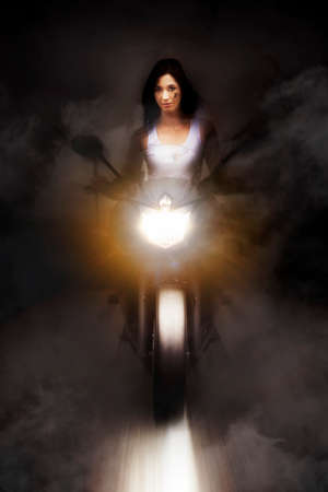 approaching: Artistic Photo Of A Person Riding A Motorcycle On A Dark Foggy Road At Speed With Headlights On High Beam In A Highway Race Conceptual