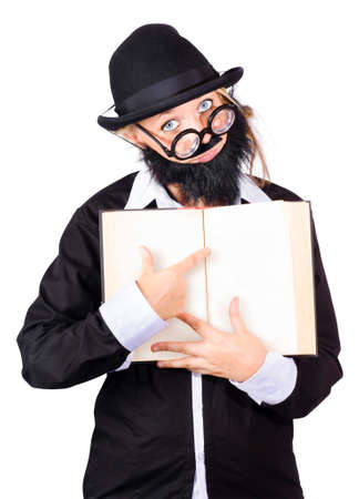 black rimmed: Strange looking woman in disguise wearing dark rimmed spectacles, black bowler hat,  fake beard and mustache pointing at blank page in book