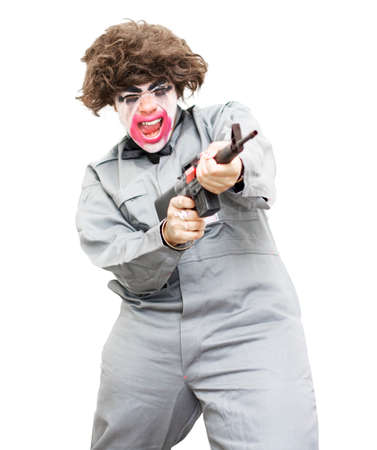 berserk: Female Psycho Killer Going Berserk Screaming Out While Firing Off Rounds From A Machine Gun – Isolated On A White Background Stock Photo