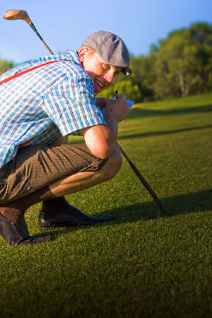 bending down: Bending Down With His Wooden Driver A Golf Player Cheats His Way To Victory In A Humorous Crouching Tiger Hidden Score Card