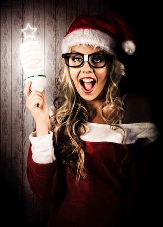 dweeb: Smart Female Santa Claus Holding Fluorescent Xmas Tree Light Bulb With Star Top In A Depiction Of A Clever Christmas Gift Idea