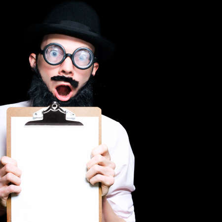 shear: Surprised Professor Holding A Clipboard With A Flabberghasted Look Of Shear Shock On Dark Studio Background