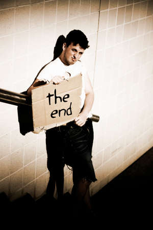 terminated: Standing On The Street At The Finish Of A Communication Presentation A Man Holds Up A Sign Stating The End