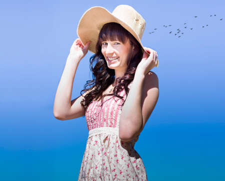 white hat: Woman With A Beautiful Smile Laughing In A Joyful Outdoor Spring Portrait Of Happiness Stock Photo