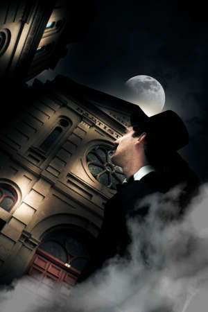 dimly: Creepy And Spooky Halloween Scene Sees A Frightened Man Standing In The Darkness Of A Full Moon During All Hallows Eve, A Night Where Evil And Horror Come To Play