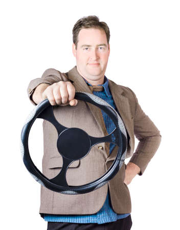 steering: Isolated image of a confident man driving car when holding steering wheel on white background Stock Photo
