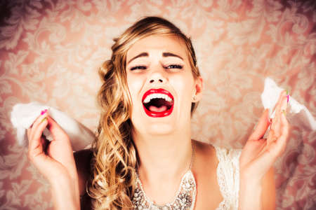 woebegone: Beautiful Vintage Bride Crying Loudly At The Alter With Tissues During Wedding Matrimony Stock Photo