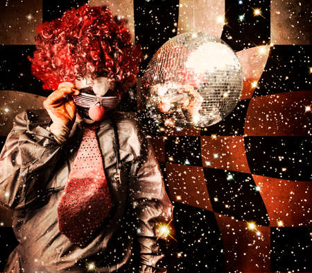 mirror ball: Distorted portrait of a 70s disc jockey clown spinning a nightclub turntable in a hallucinogenic dance trip to the stars Stock Photo