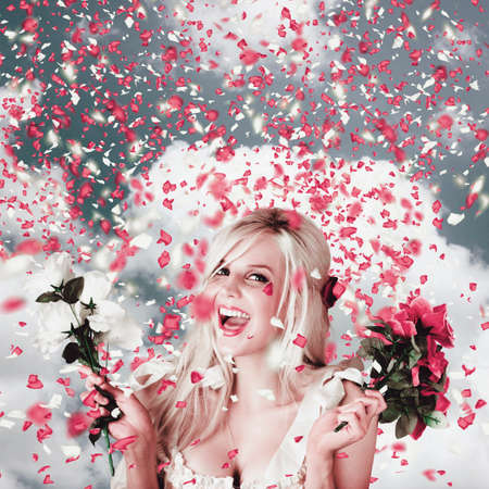 tryst: Delighted loving woman celebrating a wedding amongst falling flower confetti. Romantic celebration Stock Photo