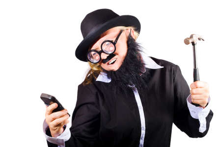 mobile telephone: Woman disguised as businessman with mobile phone and hammer, broken or out of service telephone concept on white background.