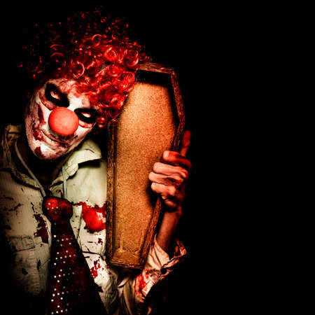clown: Grim Reaper Death Clown Holding Empty Wooden Casket When Collecting The Dead On Dark Background