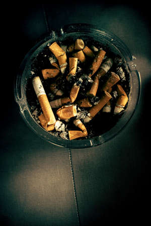 habit: A Dirty Habit Is A Ashtray Full Of Unhealthy Used Cigarette Butts Stock Photo