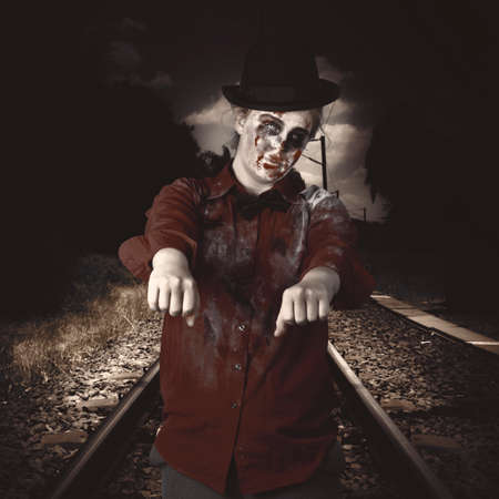 rigidity: Eerie photograph of a zombie walking down train tracks with arms stretched out in undead vintage style
