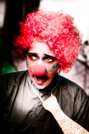 clowning: Portrait Of Ms Frightened The Scared Red Hair Clown Screaming Out In Fear And Terror With A Surprised Look Of Shock Horror Across Her Face