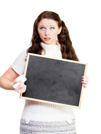 problems solutions: Teacher thinking of solutions to education problems while holding a black chalk board or blackboard with space for your educational message, on white background Stock Photo
