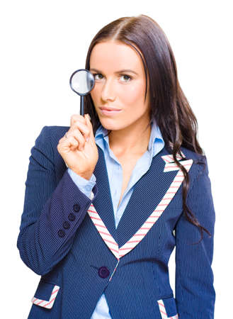scrutinise: Isolated Studio Portrait Of A Young And Pretty Business Girl Or Lady Holding A Magnifying Glass Up To Eye In A Business Analysis Review And Strategy Examination