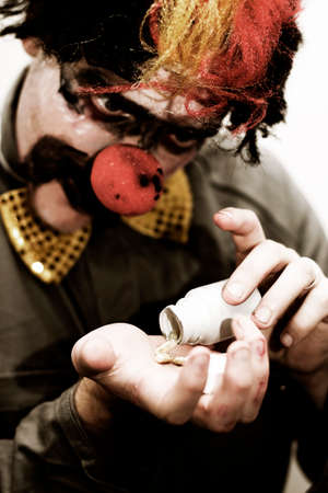 pillage: Sad Clown Desperately Pours Out Happy Pills Into His Hand To Help Cure His Sorrow