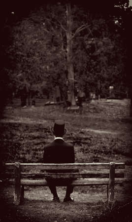 olden day: Vintage Sepia Toned Image Of A Olden Day Man Sitting On A Park Bench In A Scene Representing A Return Back To The Past