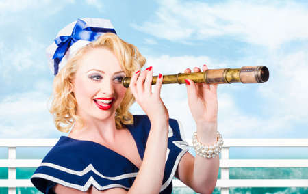 sailor girl: Color portrait of sexy young girl with beautiful curly blond hair and stylish pinup make-up looking through sailor telescope Stock Photo