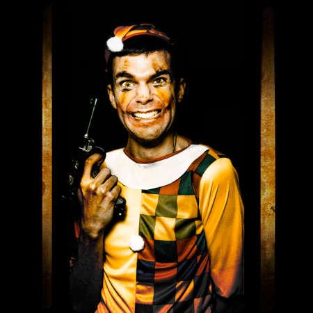 impulsive: Evil Clown With Frightening Smiling Holding Gun In Horror House Doorway