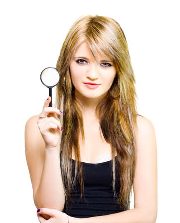 clues: Studio Image Of A Gorgeous Young Woman Holding Magnifying Glass While On A Search To Find Clues And Answer Questions Over White Background