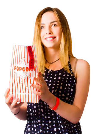 enraptured: Isolated photo of a person at movie cinema with popcorn bag and movie tickets. Box office events