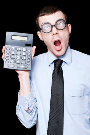 readout: Mathematical Man Holding Calculator With Shocked Expression In A Financial Solution Concept Stock Photo