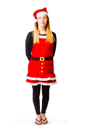 christmas characters: Full length isolated portrait of a female santas little helper standing to attention on white background. Christmas characters