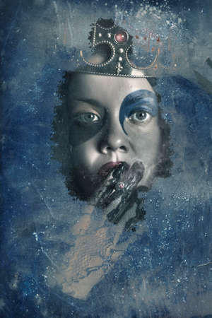 winter blues: Grunge portrait of a wicked queen smoking cigarette when looking through ice window into a frost scene of winter blues