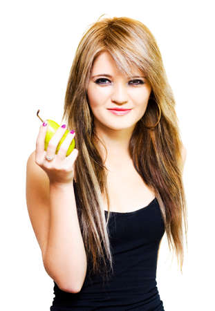 nutritional: Isolated studio photo of a healthy young woman holding up a fresh ripe pear in a healthy eating, dieting and nutrition concept on white background