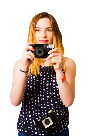 enthusiast: Isolated portrait of a female photo enthusiast capturing moments with retro film cameras. Hobby photographer